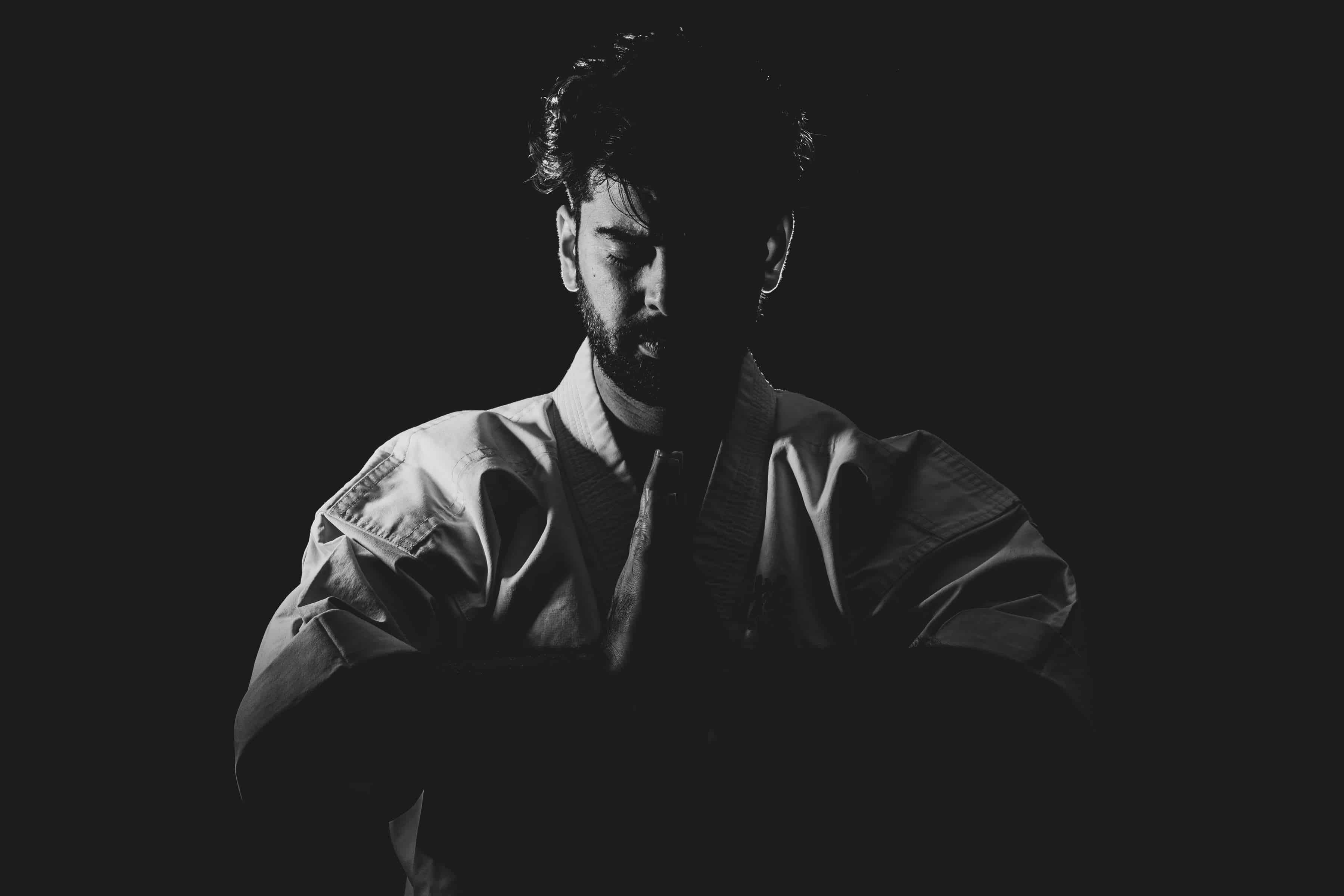 grayscale photo of martial artist