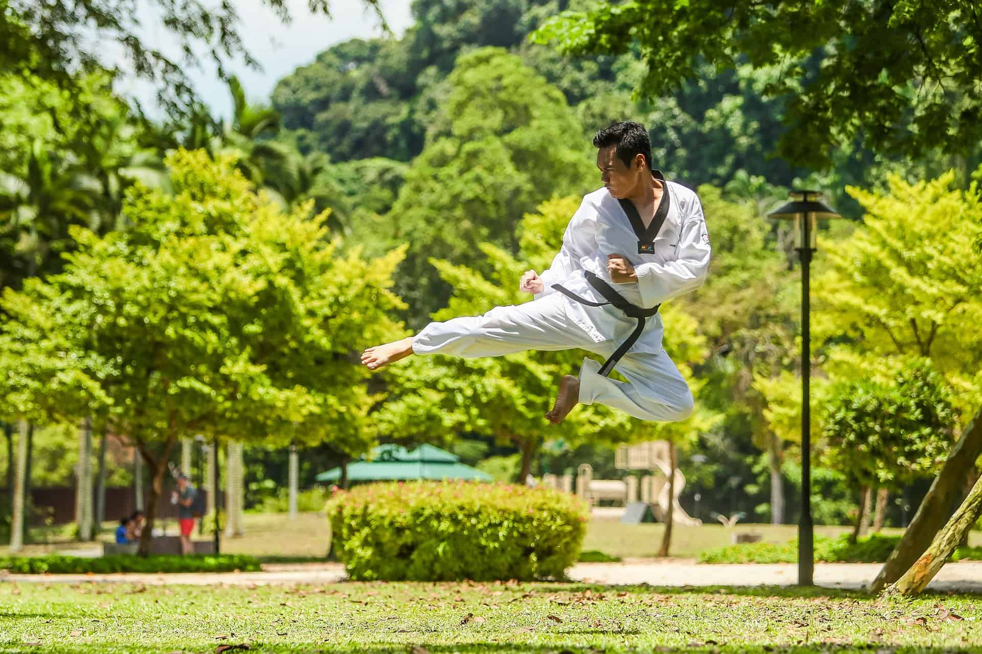 a man do a fly-kick move