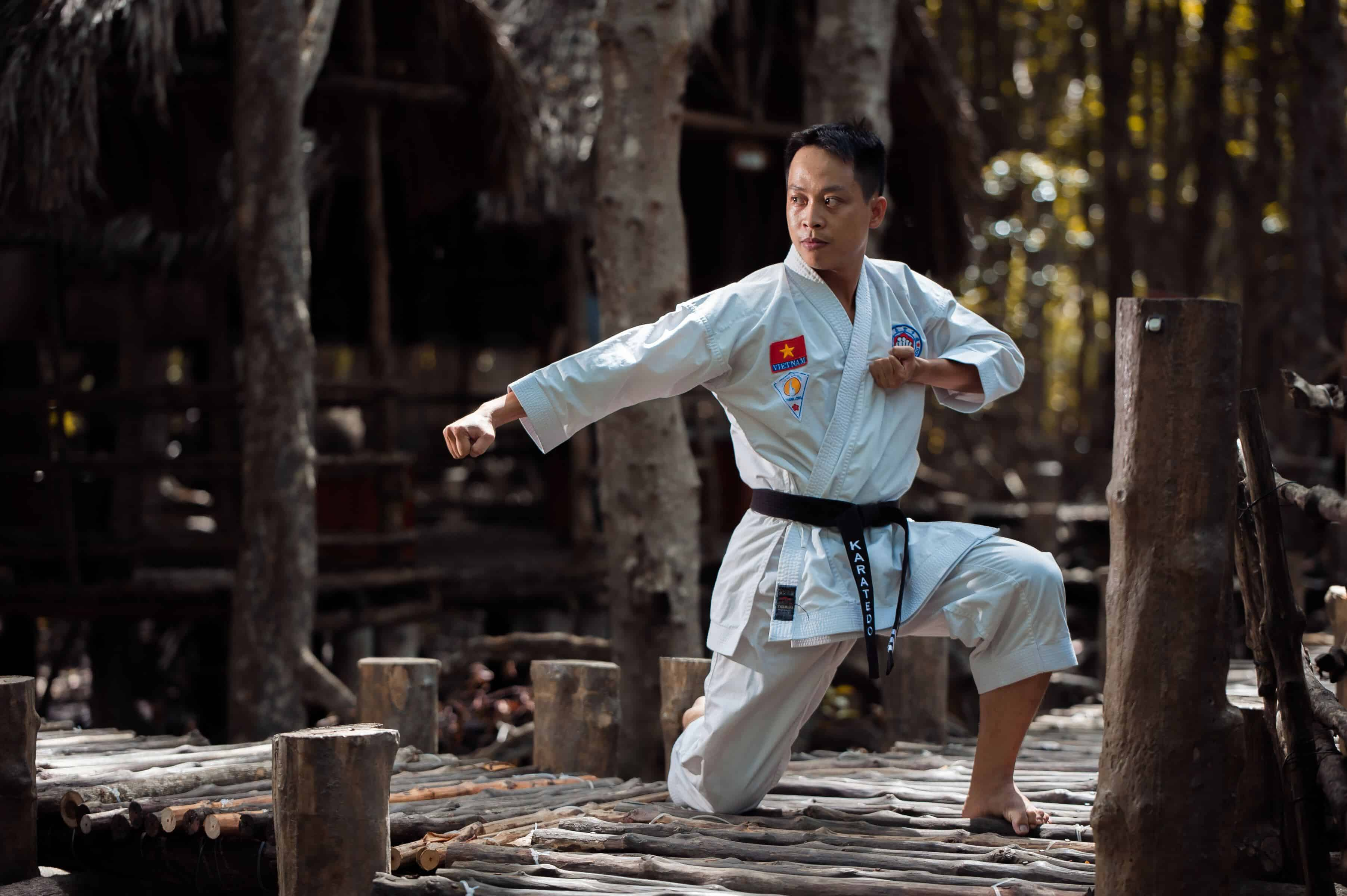 a man is doing one of the taekwondo's stance