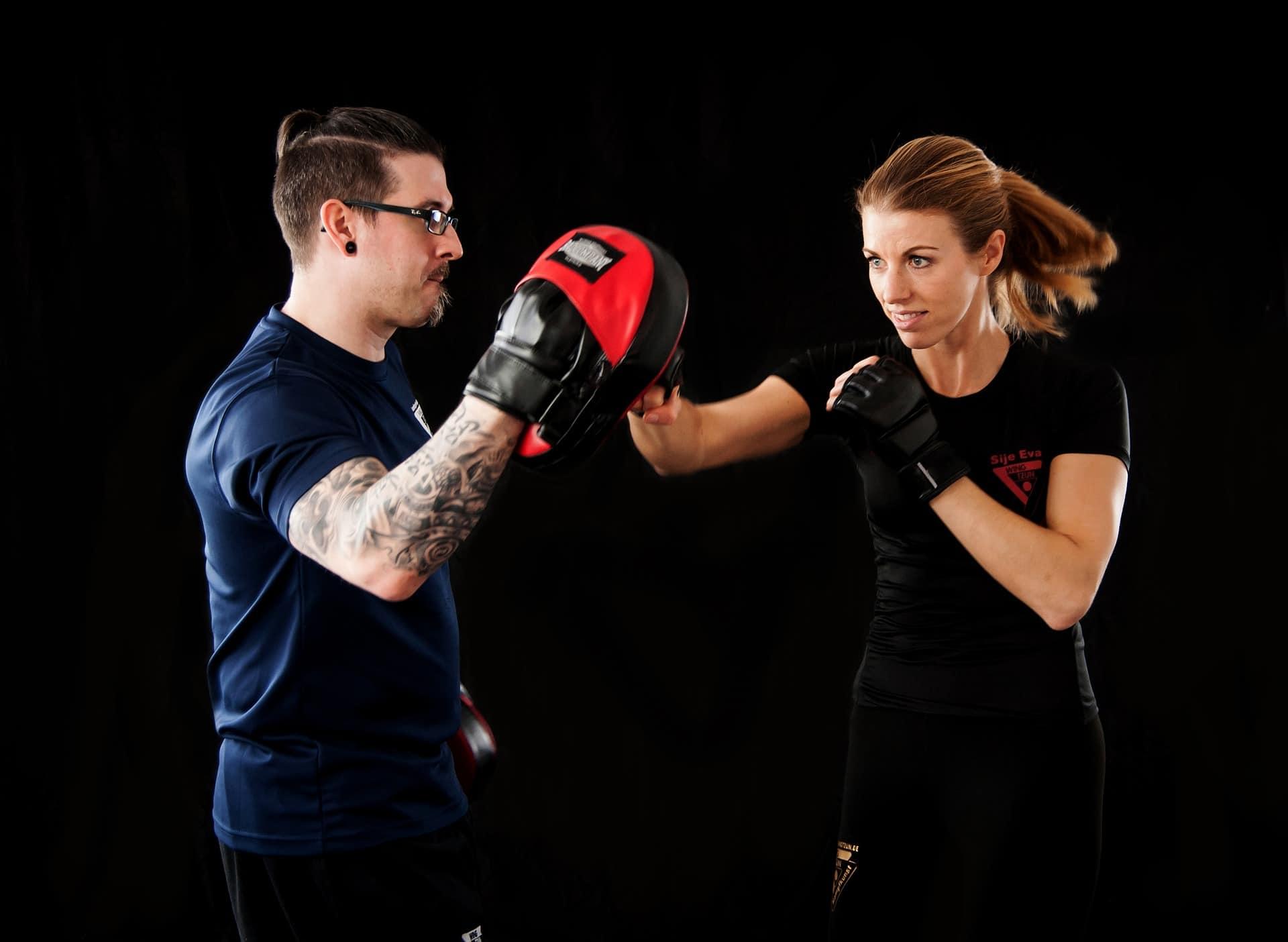 man and woman practicing martial arts